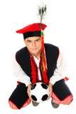 Uomo polacco in un'attrezzatura tradizionale con gioco del calcio Immagini Stock