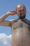 Uomo prendente il sole Fotografia Stock Libera da Diritti
