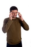 Uomo preoccupato con un'emicrania Fotografia Stock
