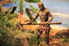 Uomo primitivo che fa bastone Fotografie Stock Libere da Diritti