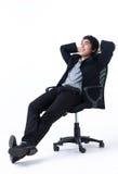 Uomo Relaxed di affari che si siede sulla presidenza Fotografia Stock