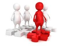 Uomo rosso del capo sul gruppo del gruppo sul puzzle Immagini Stock