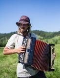 Uomo russo con la fisarmonica, agricoltore del Sud Immagini Stock