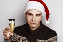 Uomo Santa Holds Champagne fotografia stock