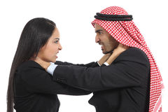 Uomo saudita arabo di affari e concorrenza della donna Immagini Stock