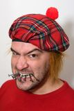 Uomo scozzese arrabbiato Fotografia Stock