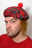 Uomo scozzese arrabbiato Immagini Stock