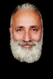 Uomo senior barbuto allegro sopra fondo nero Fotografia Stock