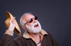 Uomo senior con il cappello di paglia Fotografia Stock
