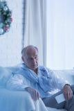 Uomo senior solo al Natale Fotografia Stock Libera da Diritti