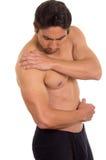 Uomo senza camicia muscolare con dolore della spalla Fotografia Stock