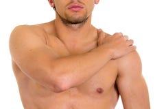 Uomo senza camicia muscolare con dolore della spalla Fotografia Stock Libera da Diritti