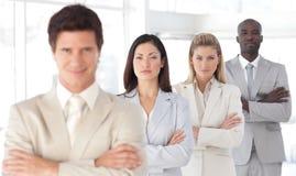 Uomo serio di affari con la squadra di affari Fotografia Stock