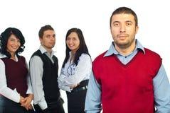 Uomo serio di affari e la sua squadra Immagine Stock