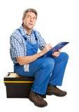 Uomo sicuro di servizio che cattura le note Fotografia Stock