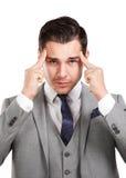Uomo sollecitato di affari con l'emicrania Fotografia Stock Libera da Diritti