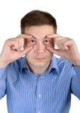 Uomo sonnolento con gli occhi sonnolenti Fotografie Stock