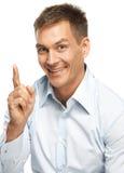 Uomo sorridente che fa un punto Fotografie Stock