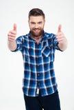 Uomo sorridente che mostra i pollici su Immagine Stock