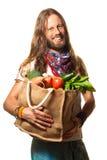 Uomo sorridente che tiene un sacchetto di frutta e delle verdure. Fotografia Stock Libera da Diritti