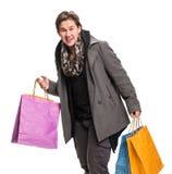 Uomo sorridente con i sacchetti di acquisto Fotografia Stock Libera da Diritti