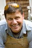 Uomo sorridente dell'operaio Immagine Stock