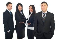 Uomo sorridente di affari e la sua squadra Fotografia Stock