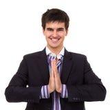 Uomo sorridente di affari nella posa del namaste Fotografia Stock Libera da Diritti