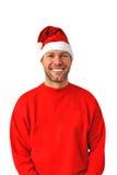 Uomo sorridente di natale che porta un cappello della Santa Fotografia Stock