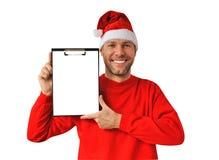 Uomo sorridente di natale che porta un cappello della Santa Fotografie Stock Libere da Diritti