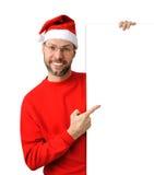 Uomo sorridente di natale che porta un cappello di Santa Fotografia Stock Libera da Diritti