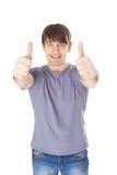 Uomo sorridente felice che sta con i pollici su isolati su bianco  Fotografia Stock