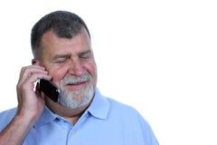 Uomo sorridente sul telefono Immagine Stock
