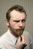 Uomo sospettoso Fotografie Stock Libere da Diritti
