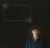 Uomo, studente o insegnante esaminante vi con il menu dell'agrifoglio di Natale per fare lista di controllo Fotografie Stock