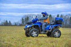 Uomo su ATV Immagine Stock