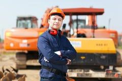 Uomo sul lavoro in un cantiere Fotografia Stock Libera da Diritti