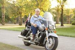 Uomo sul motociclo Fotografia Stock
