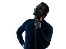 Uomo sul ritratto sorridente della siluetta del telefono Fotografie Stock Libere da Diritti