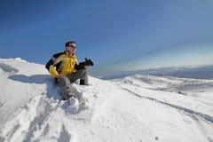 Uomo sulla montagna con la macchina fotografica Fotografie Stock