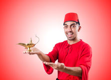 Uomo turco con la lampada sul bianco Immagine Stock