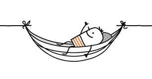 Uomo in un hammock Immagini Stock Libere da Diritti