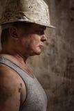 Uomo in un minatore del casco Fotografie Stock