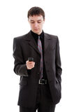 Uomo in un vestito, manopole un numero nel telefono. Immagine Stock Libera da Diritti