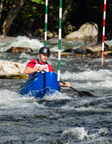 Uomo in una canoa del whitewater Immagini Stock Libere da Diritti