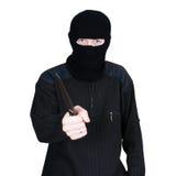 Uomo in una mascherina con una lama su un bianco fotografie stock libere da diritti