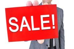 Uomo in vestito con un'insegna con la vendita del testo Fotografie Stock Libere da Diritti