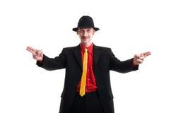 Uomo in vestito e cappello su bianco Immagine Stock