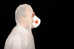 Uomo in vestito protettivo Fotografie Stock Libere da Diritti