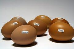 Uova con i nomi Immagini Stock
